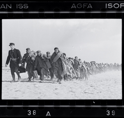 Exiled Republicans being marched down the beach to an internment camp, Le Barcares, France March, 1939 by Robert Capa. Source: icp.org