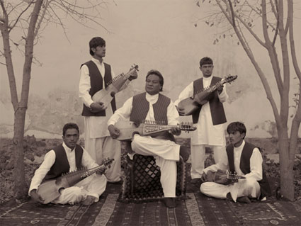 At A Music School In Kabul, Boys Are Taught The Traditional Afghan Instrument, The Rubab by Simon Norfolk. Source: bonnibenrubi.com