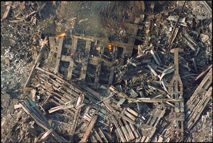 Iron workers cut the remaining structure of the North Tower, 12/16/2001], from Above Ground Zero. by Gregg Brown. Source: icp.org